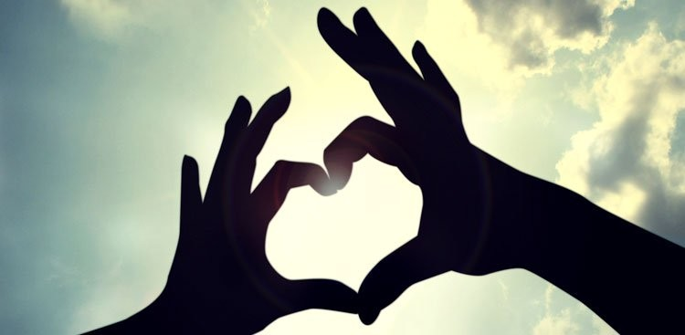 Hands Holding Up Heart Sign