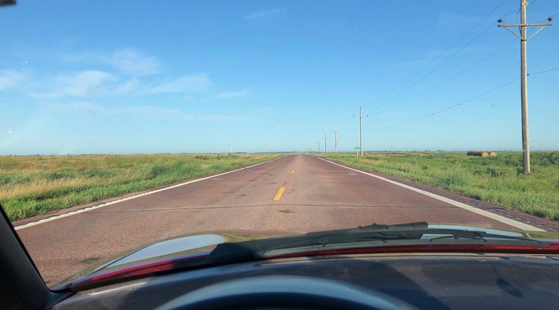 Vehicle Dash Looking Into Prairie Landscape